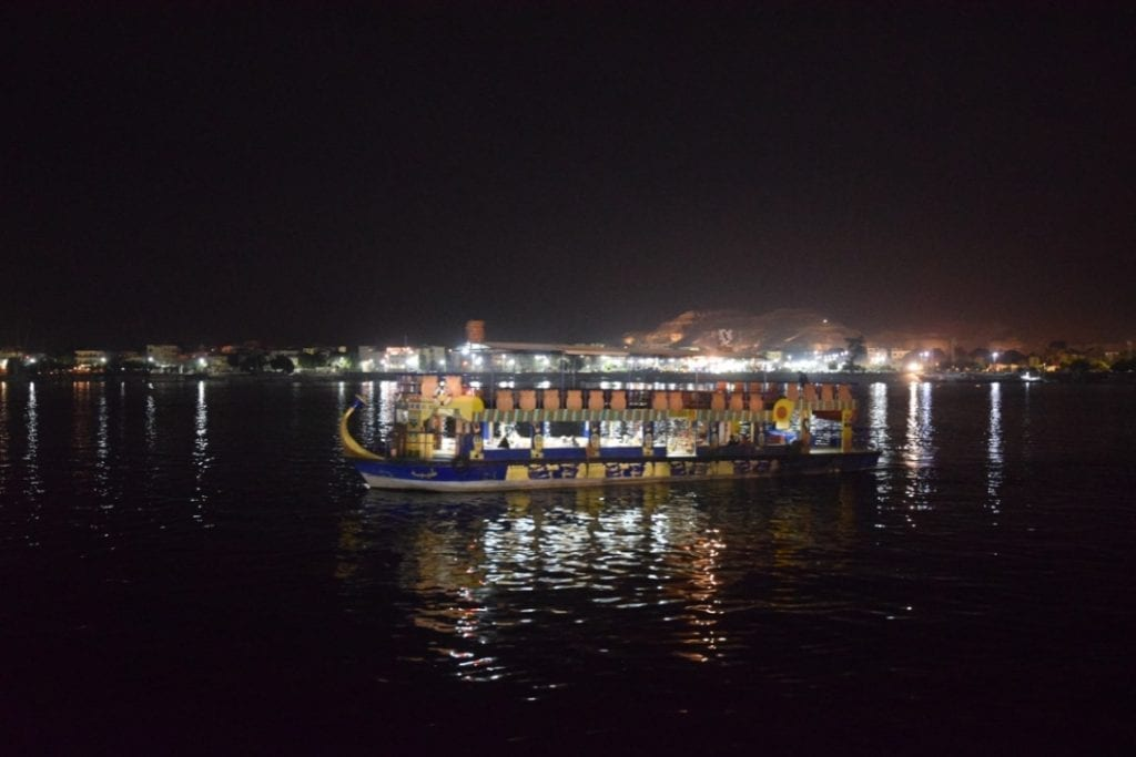 A boat during night time in the Nile river in Luxor.