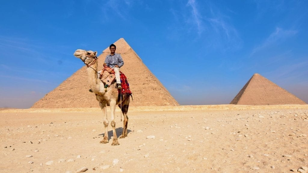 Camel ride in front of pyramid of Giza.