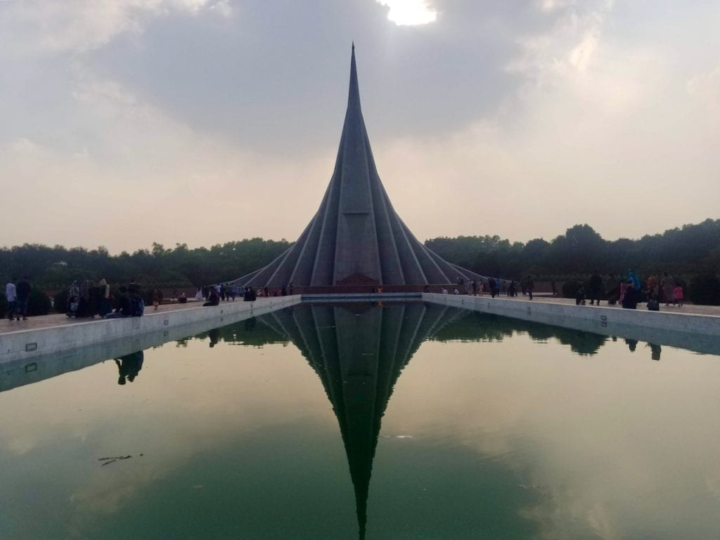 Reflection of national monument of Bangladesh on the water.