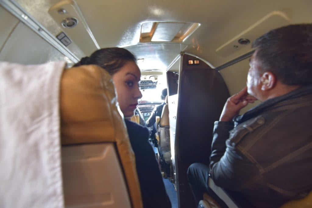 The lady is the cabin crew, the pilot is at the front in cockpit, all open in the plane