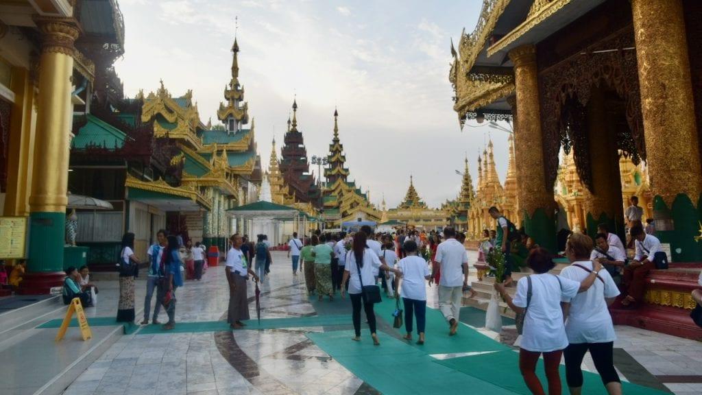People are circumnavigating the Shwedagon Pagoda
