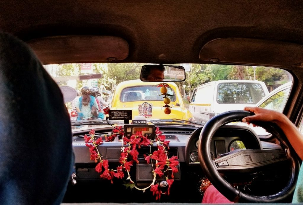 Take the iconic yellow taxi cab as part of the places to visit in Kolkata.