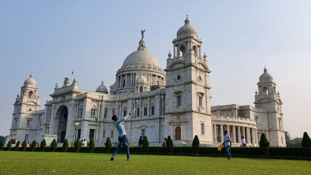 People are playing in front of the Victoria Memorial in Kolkata.