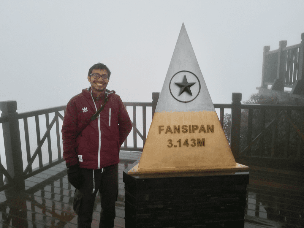 awalkintheworld author on top of Mount Fansipan