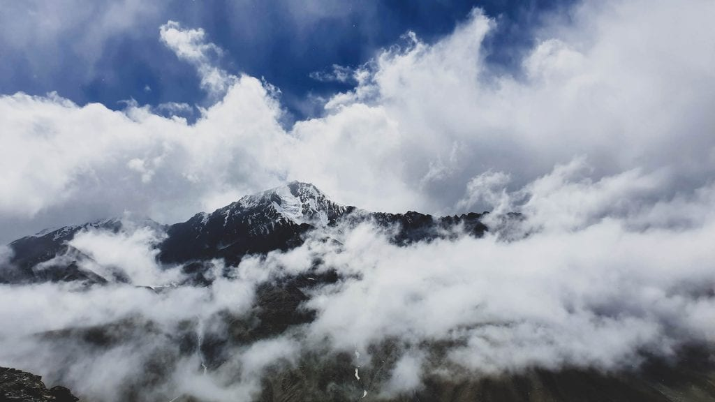 Barren mountains covered with clouds in Spiti Valley.