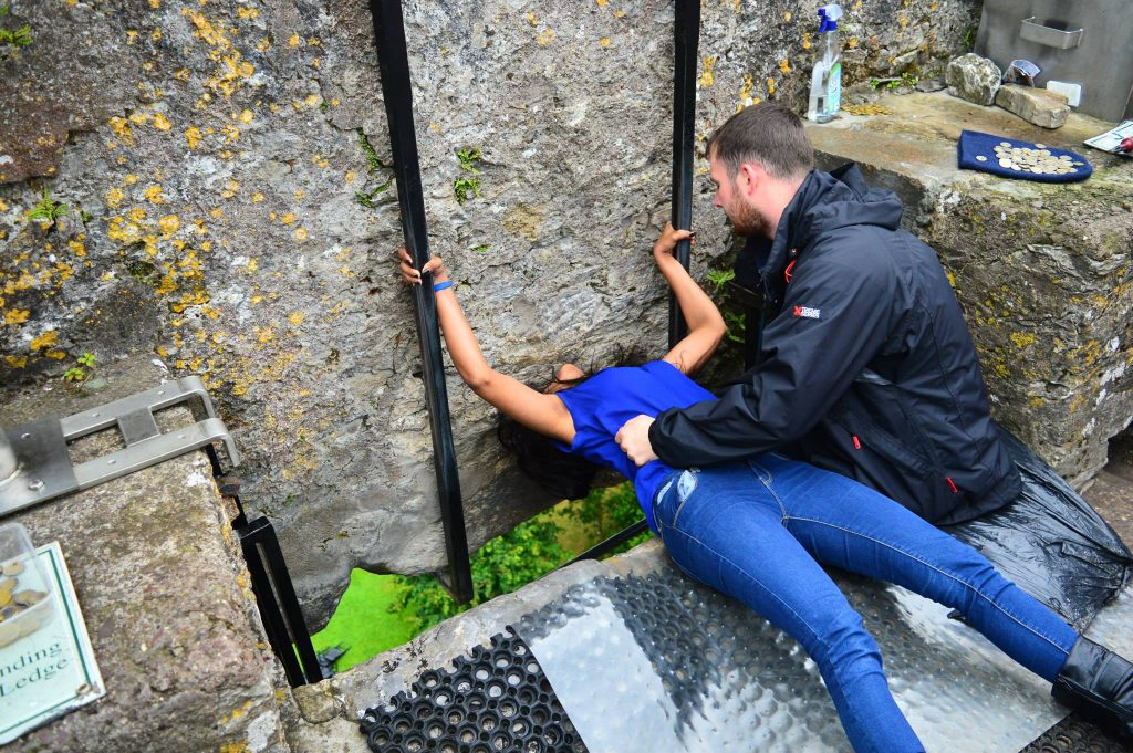 Kissing the Blarney Stone in Blarney Castle.