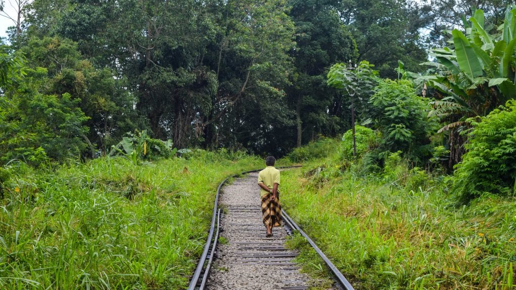 Man Walking on a Train Line in Ella