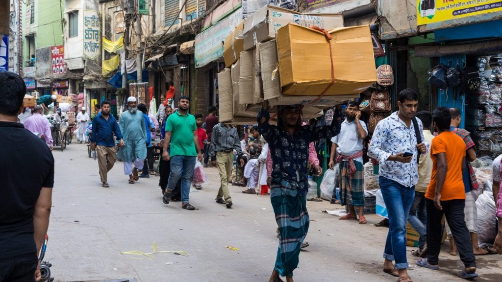 Multiple Packets On Head of a person in Old Dhaka