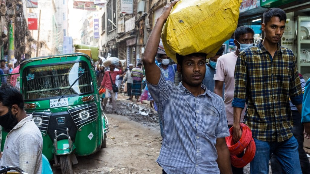 People Carrying Goods in Old Dhaka