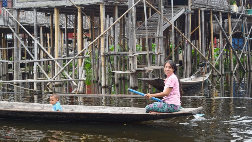 Lady and kids on a boat in Inle Lake